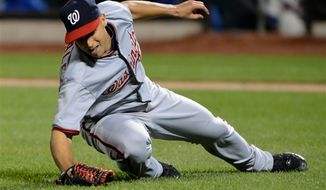 Washington Nationals' Gio Gonzalez fields a ground ball hit by the New York Mets' David Wright who he then threw out in the fifth inning of the baseball game at Citi Field in New York, Monday, Sept. 10, 2012. (AP Photo/Henny Ray Abrams)
