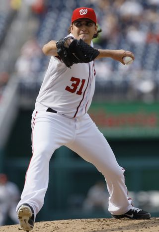 Washington Nationals starting pitcher John Lannan delivers in the second inning during the first baseball game of a doubleheader against the Miami Marlins, Friday, Aug. 3, 2012, in Washington. (AP Photo/Carolyn Kaster)