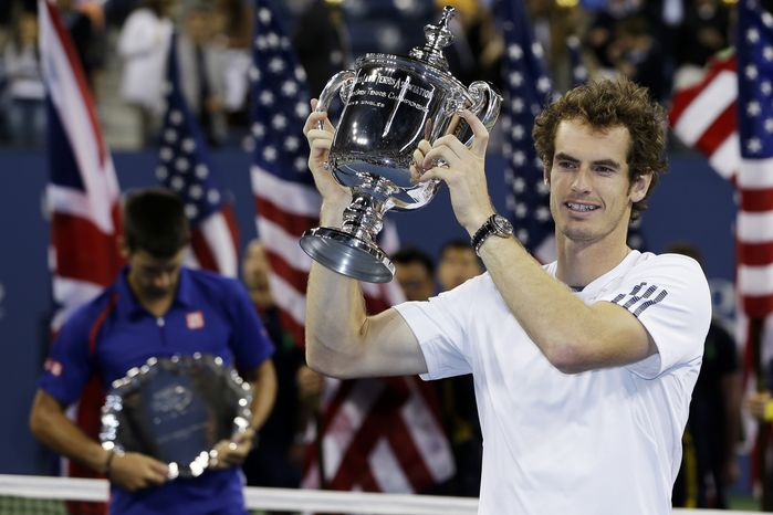 Britain's Andy Murray poses with the trophy after defeating Serbia's Novak Djokovic in the championship match at the U.S. Open tennis tournament, Monday, Sept. 10, 2012, in New York. Murray won 7-6 (10), 7-5, 2-6, 3-6, 6-2. (AP Photo/Mike Groll)