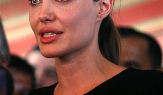 ** FILE ** Angelina Jolie, the U.N. refugee agency's special envoy, speaks to the press during her visit to the Zaatari Syrian Refugees Camp in Mafraq, Jordan, on Tuesday, Sept. 11, 2012. The Hollywood star arrived on Tuesday morning in the Zaatari camp, which hosts about 27,000 Syrians displaced by the 18-month conflict in their homeland. (Associated Press)
