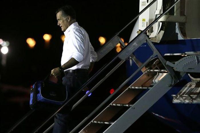 Republican presidential candidate and former Massachusetts Gov. Mitt Romney arrives in Jacksonville, Fla., Tuesday, Sept. 11, 2012. (AP Photo/Charles Dharapak)