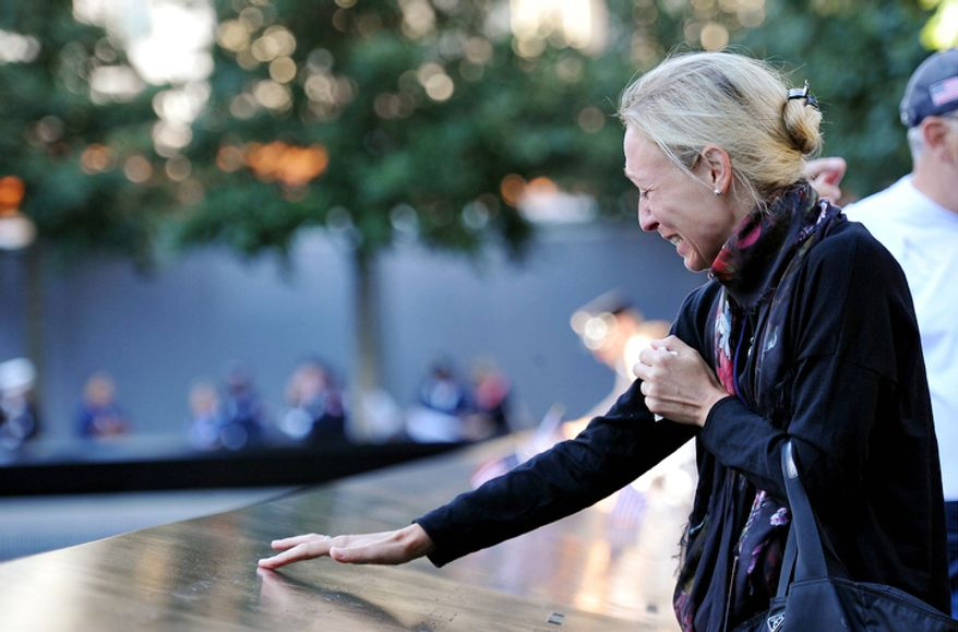 ** FILE ** Carrie Bergonia remembers her fiance, firefighter Joseph Ogren, who was killed in the terrorist attacks of Sept. 11, 2001, during a ceremony marking the 11th anniversary of the attacks at the National Sept. 11 Memorial at the World Trade Center site. (AP Photo/The Daily News, Todd Maisel, Pool)