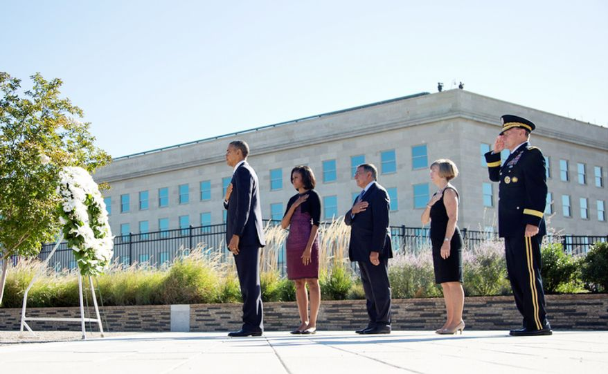 President Obama, accompanied by first lady Michelle Obama, Defense Secretary Leon E. Panetta, Deanie Dempsey and Gen. Martin Dempsey, pauses after placing a wreath at the Pentagon on Tuesday, Sept. 11, 2012, during a ceremony to mark the 11th anniversary of the Sept. 11 attacks. (AP Photo/Carolyn Kaster)