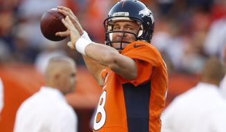 Denver Broncos quarterback Peyton Manning throws before the start of an NFL football game between the Denver Broncos and the Pittsburgh Steelers at Sports Authority Field at Mile High, Sunday, Sept. 9, 2012 in Denver. (AP Photo/David Zalubowski)
