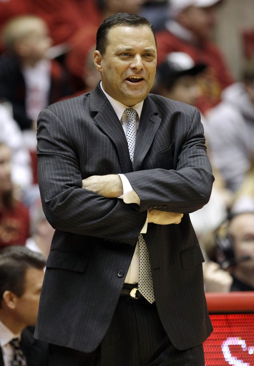 FILE - In this Feb. 22, 2012, file photo, Texas Tech coach Billy Gillispie watches during the first half of an NCAA college basketball game against Iowa State in Ames, Iowa. Gillispie has been hospitalized for an undisclosed medical issue.  Athletic department spokesman Blayne Beal said the 52-year-old coach was admitted to University Medical Center early Friday, Aug. 31, 2012. He declined to provide further details. (AP Photo/Charlie Neibergall, File)