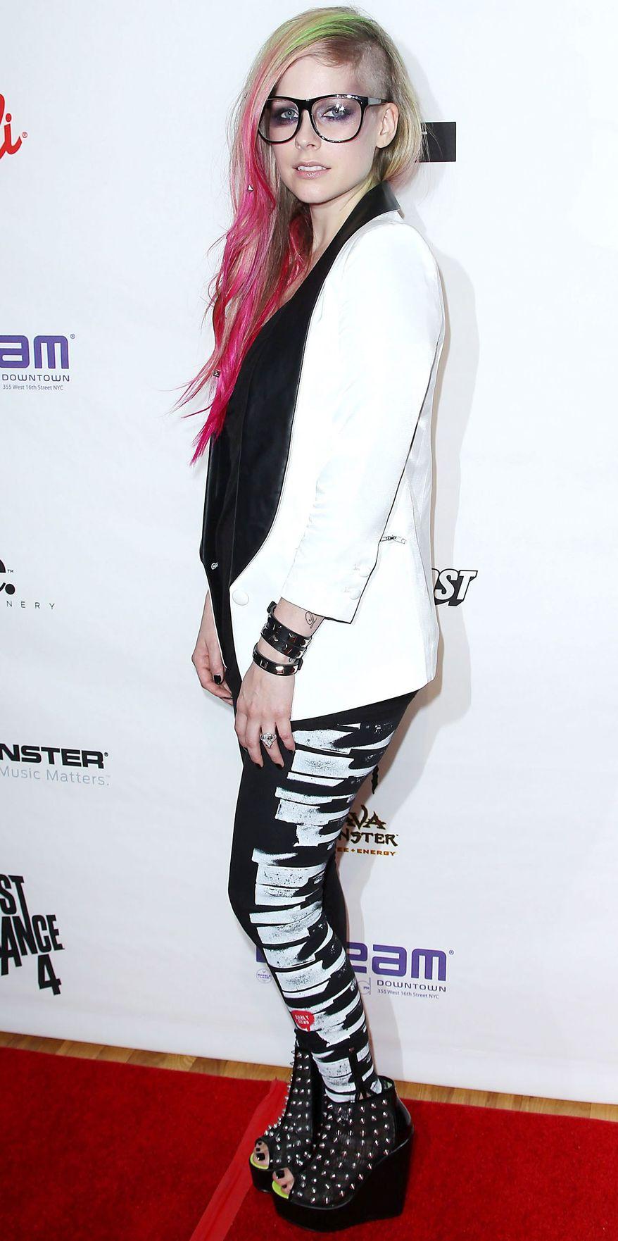 Pop star Avril Lavigne promises she will wear a wedding dress that she might make herself when she marries her fiance, rocker Chad Kroeger. (Associated Press)
