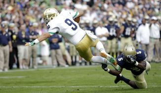 Notre Dame's Louis Nix III, left,  is tackled by Navy's Quincy Adams, right, during their  NCAA college football game  in Dublin, Ireland, Saturday, Sept. 1, 2012.  (AP Photo/Peter Morrison)