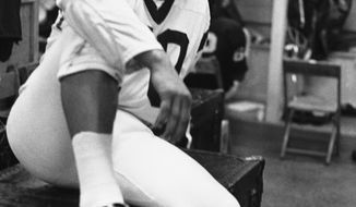Sam Huff, famed by the Associated Press as defensive player of the week for the National Football League in the Washington Redskins locker room in Washington on Sept. 25, 1969. Huff made 12 tackles and five assists Sunday for Washington in a 26-20 defeat of New Orleans. (AP Photo/Charles Gorry)