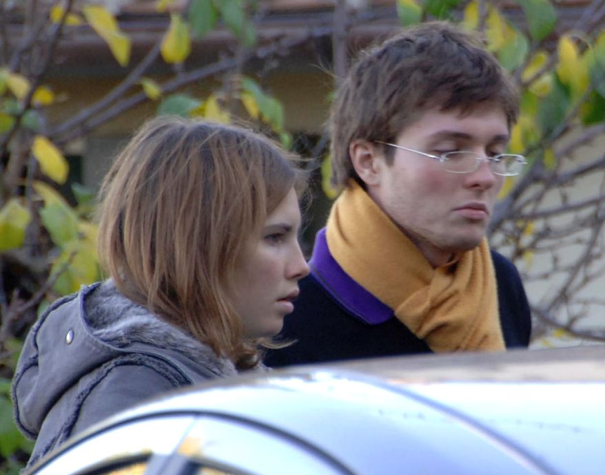 ** FILE ** Amanda Knox and then-boyfriend Raffaele Sollecito are pictured in November 2007 outside the rented house in Perugia, Italy, where 21-year-old British student Meredith Kercher was found dead. (AP Photo/Stefano Medici)
