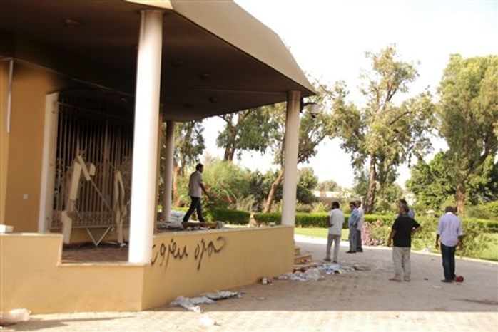 ** FILE ** Libyans gather at the gutted U.S. consulate in Benghazi, Libya, after an attack that killed four Americans, including Ambassador Chris Stevens, Wednesday, Sept. 12, 2012. (AP Photo/Ibrahim Alaguri)