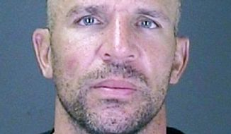 In this photo released by the Southampton, N.Y. Police, Monday, July 16, 2012, New York Knicks' Jason Kidd is shown following his arrest. Kidd intends to fight a charge that he was drunk when he crashed his SUV into a telephone pole in the Hamptons over the summer, his lawyer said Wednesday, Sept. 12, 2012. (AP Photo/Southampton Town Police)