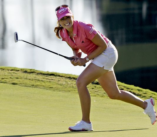 Paula Creamer reacts to a missed birdie putt on the 18th green during one of eight playoff holes with Jiyai Shin, of South Korea, during the Kingsmill Championship LPGA Tour golf tournament in Williamsburg, Va., Sunday, Sept. 9, 2012. Both players failed to birdie and will return to continue the playoff on Monday. (AP Photo/Steve Helber)