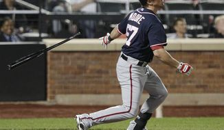 Tyler Moore of the Washington Nationals follows through on a two-run home run during the seventh inning of a baseball game against the New York Mets on Tuesday, Sept. 11, 2012, in New York. (AP Photo/Frank Franklin II)