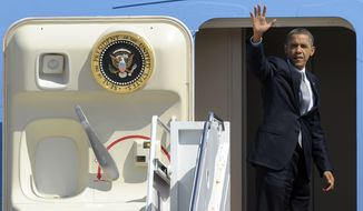 President Barack Obama waves from the steps of Air Force One at Andrews Air Force Base in Md., Wednesday, Sept. 12, 2012. Obama is traveling to Las Vegas and Colorado to campaign (AP Photo/Susan Walsh)