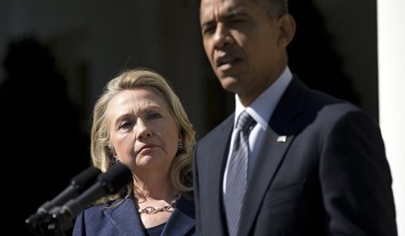 Secretary of State Hillary Rodham Clinton listens as President Obama speaks Sept. 12, 2012, in the Rose Garden of the White House in Washington on the death of Christopher Stevens, U.S. ambassador to Libya. (Associated Press)