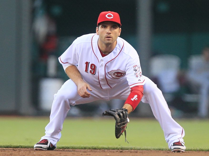 Cincinnati Reds' Joey Votto in action against the Pittsburgh Pirates in inning of a baseball game, Tuesday, Sept. 11, 2012, in Cincinnati. (AP Photo/Al Behrman)