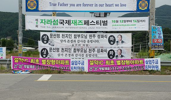 Signs in all languages honoring the late Rev. Sun Myung Moon have been hung on the road to the Cheongpyeong Heaven and Earth Training Center complex near Seoul, Korea to pay tribute to the father of the Unification Church. The official funeral services will be held Saturday, Sept. 15. Thirty thousand mourners from around the world are expected to attend. (Barbara L. Salisbury/The Washington Times)
