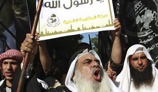 """Palestinians protest against the movie, """"Innocence of Muslims,"""" near the United Nations office in Gaza City, Wednesday, Sept. 12, 2012. (AP Photo/Adel Hana)"""
