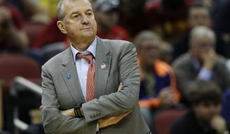 ** FILE ** In this March 15, 2012 photo, Connecticut head coach Jim Calhoun watches from the sideline in the first half of their second-round NCAA tournament basketball game against Iowa State in Louisville, Ky. Calhoun is expected to announce his retirement on Thursday, Sept. 13, according to a person familiar with the situation. (AP Photo/John Bazemore, File)