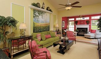 The Griffin Hall model features a great room with a sloped ceiling.