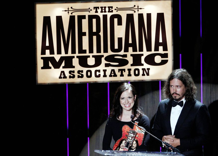 Entertainers Joy Williams and John Paul White of The Civil Wars speak Wednesday after receiving the Duo/Group of the Year award at the 11th annual Americana Honors & Awards in Nashville, Tenn. (Associated Press)