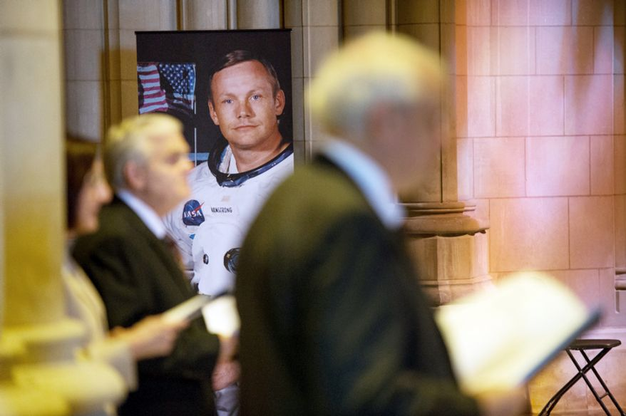 Attendees listen to a memorial service for Neil Armstrong at the National Cathedral, Washington, D.C., Thursday, September 13, 2012. (Andrew Harnik/The Washington Times)