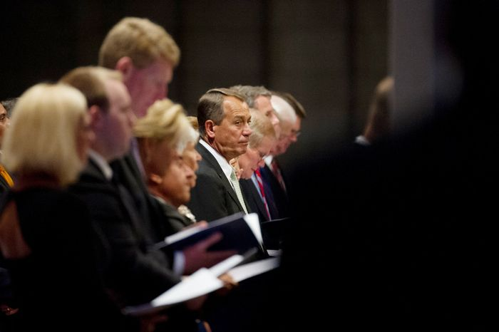 Speaker John Boehner (R-Ohio), center, attends a memorial service for Neil Armstrong at the National Cathedral. (Andrew Harnik/The Washington Times)