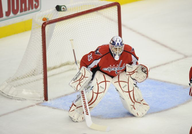 Washington Capitals goalie Dany Sabourin in goal during an NHL preseason hockey game against the Nashville Predators, Sunday, Oct. 3, 2010, in Washington. (AP Photo/Nick Wass)