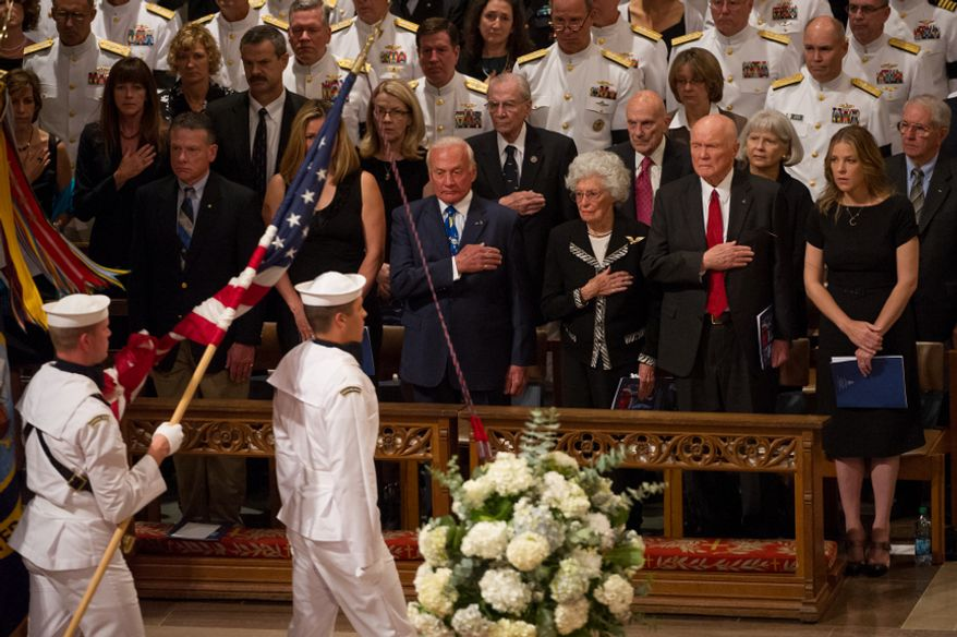 Astronaut Buzz Aldrin, fourth from right, Annie Glenn, third from right, her husband, astronaut and Sen. John Glenn (D-Ohio), second from right, and singer Diana Krall, right, watch as the flags are marched into the memorial service for Neil Armstrong at the National Cathedral, Washington, D.C., Thursday, September 13, 2012. (Andrew Harnik/The Washington Times)