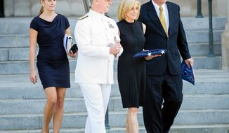 Carol Armstrong (second from right), wife of late astronaut Neil Armstrong, is escorted Sept. 13, 2012, out of the National Cathedral in Washington following a memorial service for her husband. (Andrew Harnik/The Washington Times)
