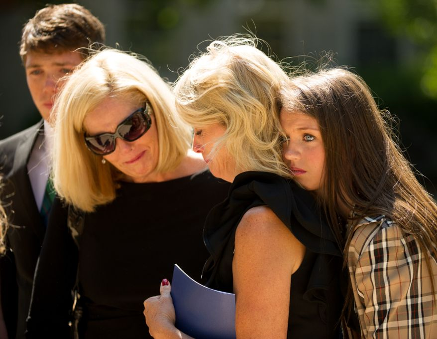Left to right: Neil Armstrong family members John Egan, his mother Ellen Egan, Ann Heide, and Ann's daughter Ashton console each other outside of the National Cathedral following a memorial service for Neil Armstrong, Washington, D.C., Thursday, September 13, 2012. (Andrew Harnik/The Washington Times)