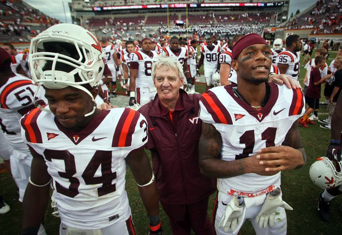 Virginia Tech head coach Frank Beamer sings the Alma Mater with Kyshoen Jarrett (34) and Dyrell Roberts (11) after an NCAA college football game against Austin Peay in Blacksburg, Va., Saturday, Sept. 8, 2012. (AP Photo/The Roanoke Times, Daniel Lin)  LOCAL TV OUT; SALEM TIMES REGISTER OUT; FINCASTLE HERALD OUT;  CHRISTIANBURG NEWS MESSENGER OUT; RADFORD NEWS JOURNAL OUT; ROANOKE STAR SENTINEL OUT