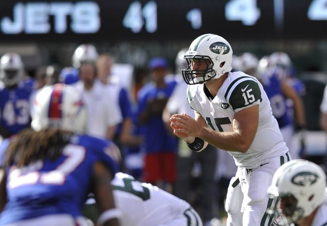 FILE - This Sept. 9, 2012 file photo shows New York Jets quarterback Tim Tebow calling signals during the fourth quarter of an NFL football game against the Buffalo Bills, in East Rutherford, N.J. A sprinkling of Tebow and the wildcat package turned out to be more than enough against the Bills. Now the Jets, at Pittsburgh on Sunday, will have to decide whether to give Tebow more snaps or even fewer.  (AP Photo/Bill Kostroun, File)