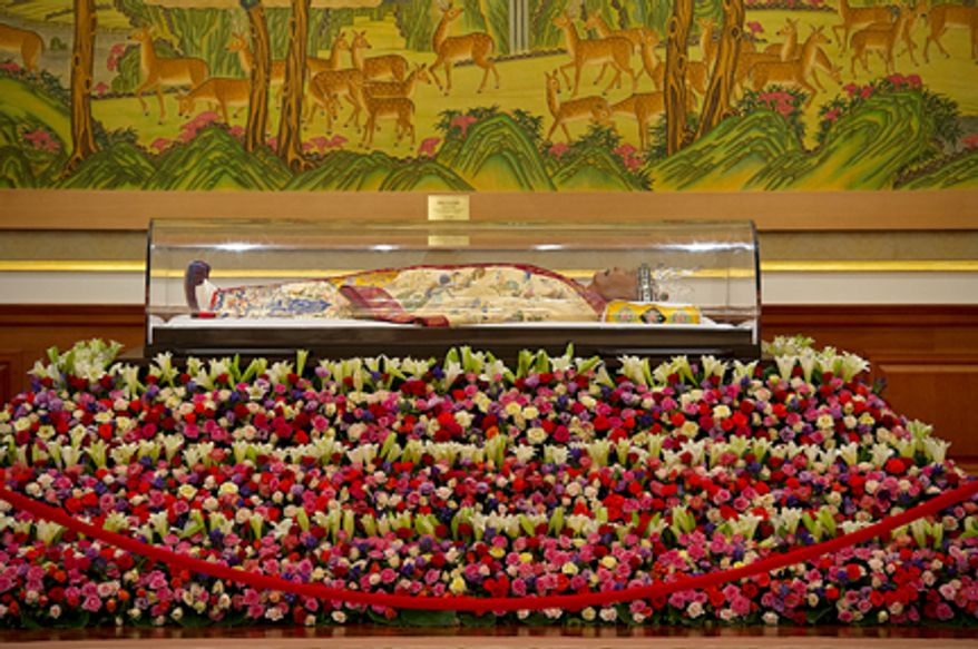 """The body of the late Rev. Sun Myung Moon lies at the palace in the Cheong Shim Peace World Center in Gapyeong-gun, Korea, on Thursday, Sept. 13, 2012. Mourners are invited to come pay tribute to the """"True Father,"""" offering him prayers and paying respect to his family. His 13-day mourning period culminates on Saturday with an official funeral service. (Barbara L. Salisbury/The Washington Times)"""