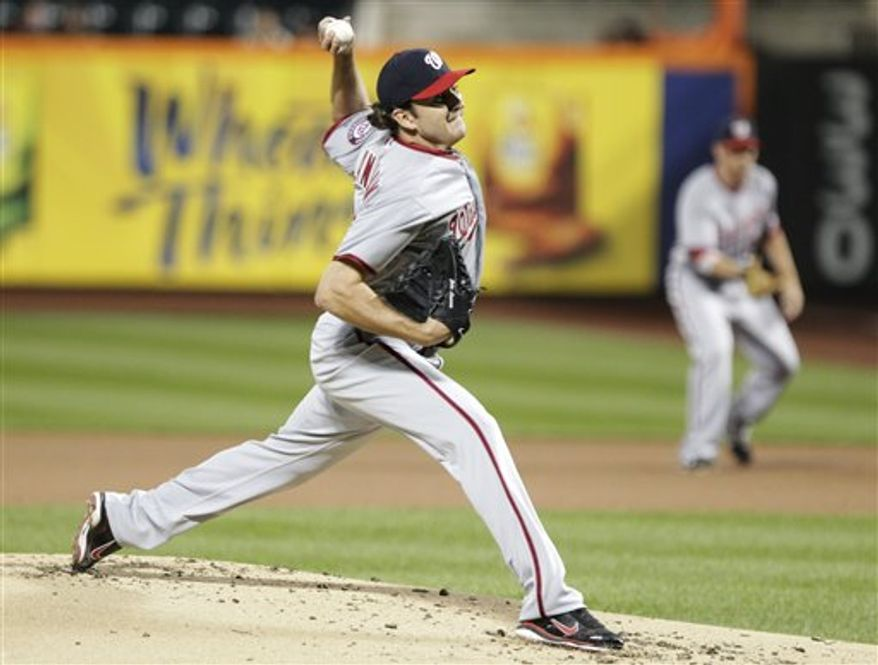 Washington Nationals' John Lannan delivers a pitch during the first inning of a baseball game against the New York Mets, Wednesday, Sept. 12, 2012, in New York. (AP Photo/Frank Franklin II)