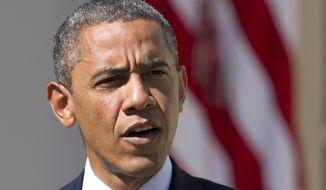 **FILE** President Obama speaks Sept. 12, 2012, in the Rose Garden of the White House in Washington. (Associated Press)