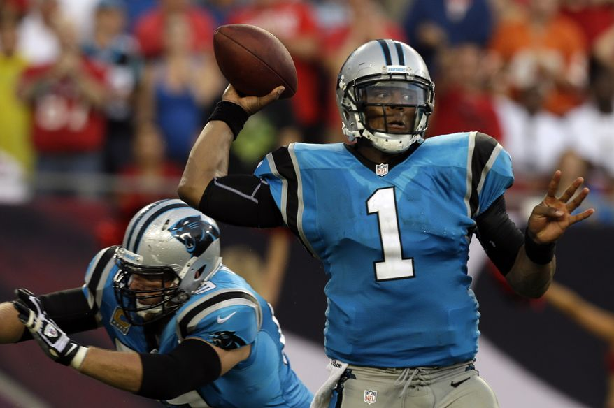 Carolina Panthers quarterback Cam Newton (1) throws a pass against the Tampa Bay Buccaneers during the fourth quarter of an NFL football game Sunday, Sept. 9, 2012, in Tampa, Fla. (AP Photo/Chris O'Meara)