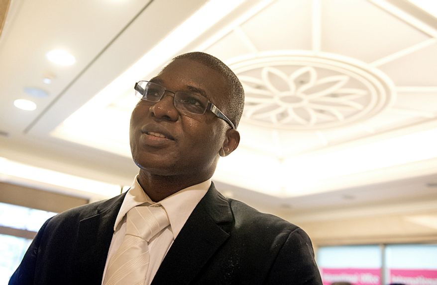 """Kone Drissa, who is originally from the Ivory Coast but who now lives in New York, says, """"We believe he [Rev. Moon] has done whatever he had to do, and we want to continue honoring him.""""  (Barbara L. Salisbury/The Washington Times)"""