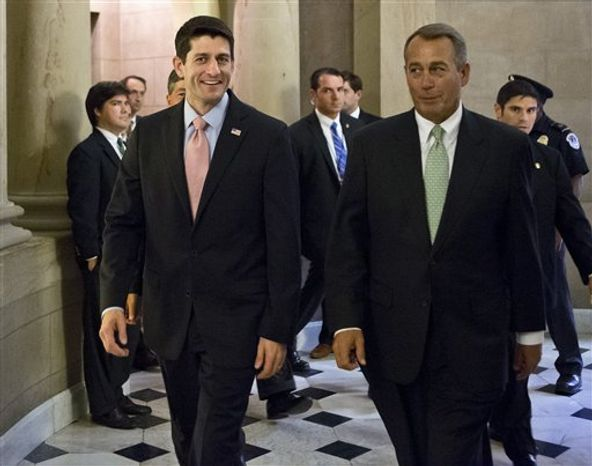 Walking with House Speaker John Boehner, R-Ohio, right, Rep. Paul Ryan, R-Wis., the Republican vice presidential candidate, returns to Capitol Hill to vote on a stopgap spending bill that avoids a government shutdown but carries a price tag $19 billion higher than the budget he wrote as chairman of the House Budget Committee, in Washington, Thursday, Sept. 13, 2012. (AP Photo/J. Scott Applewhite)