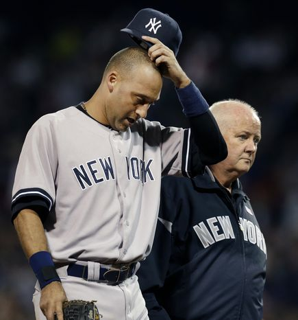 New York Yankees' Derek Jeter leaves the game with team trainer Steve Donohue after he was injured trying to beat out a grounder during the eighth inning of a baseball game against the Boston Red Sox at Fenway Park in Boston Wednesday, Sept. 12, 2012. (AP Photo/Elise Amendola)