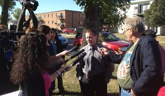 Lt. Joel Vettel of the Fargo Police Department talks to the media near the North Dakota State University campus in Fargo, N.D., following a bomb threat that forced the evacuation of the campus on Friday, Sept. 14, 2012. Thousands of people streamed off university campuses in Texas and North Dakota on Friday after phoned-in bomb threats prompted evacuations and officials warned students and faculty to get away as quickly as possible. No bombs had been found on either campus by midmorning and it was not clear whether the threats were related. (AP Photo/The Forum, Ryan Babb)
