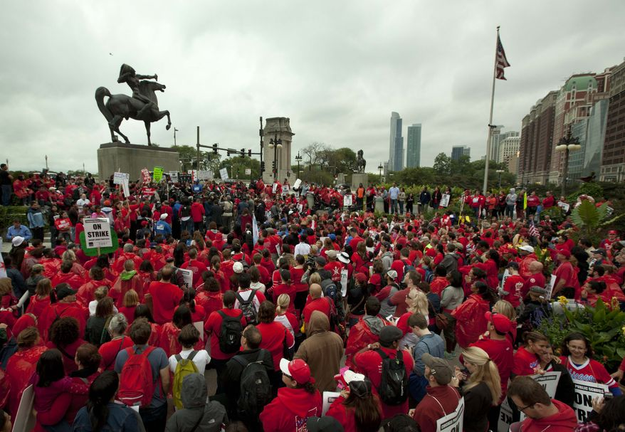 A large crowd of public school teachers rally at Chicago's Congress Plaza on Sept. 13, 2012, to protest against billionaire Hyatt Hotel mogul Penny Pritzker, who is also a member of the Chicago Board of Education. Protesters said that $5.2 million in Tax Increment Financing (TIF) funds being used to build a new Hyatt hotel in Hyde Park would be better spent on meeting basic student needs. (Associated Press)