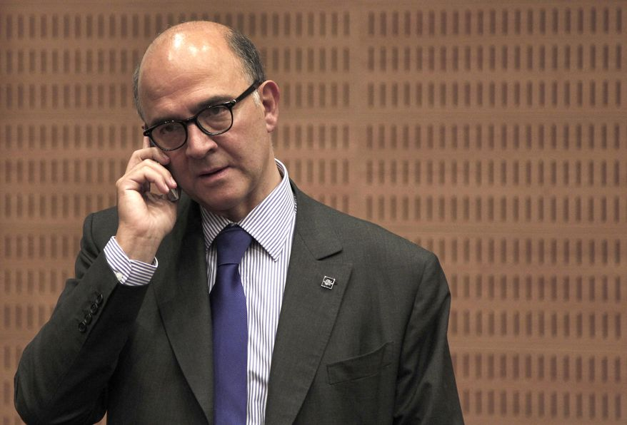French Finance Minister Pierre Moscovici talks on his cell phone Sept. 14, 2012, prior of the Informal European economic and financial affairs council in capital Nicosia, Cyprus. European finance ministers are gathering in Cyprus for two days of discussions about the debt crisis and the latest developments in Greece and Spain. (Associated Press)