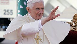 Pope Benedict XVI waves his hand upon arrival at Rafik Hariri international airport in Beirut on Sept. 14, 2012. (Associated Press)