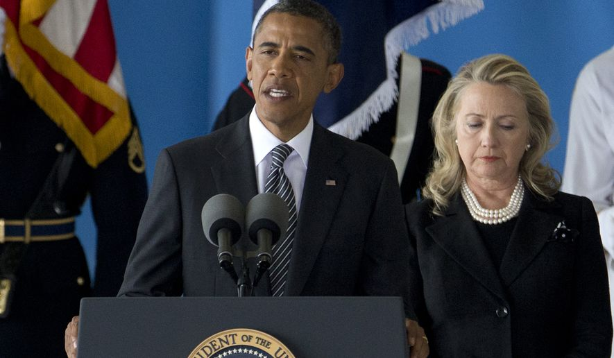 President Obama, accompanied by Secretary of State Hillary Rodham Clinton, speaks Sept. 14, 2012, during a ceremony at Andrews Air Force Base, Md., marking the return to the United States of the remains of the four Americans killed earlier in the week in Benghazi, Libya. (Associated Press) **FILE**