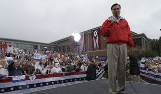 Republican presidential candidate and former Massachusetts Gov. Mitt Romney campaigns in the rain at Lake Erie College in Painesville, Ohio, Friday, Sept. 14, 2012. (AP Photo/Charles Dharapak)