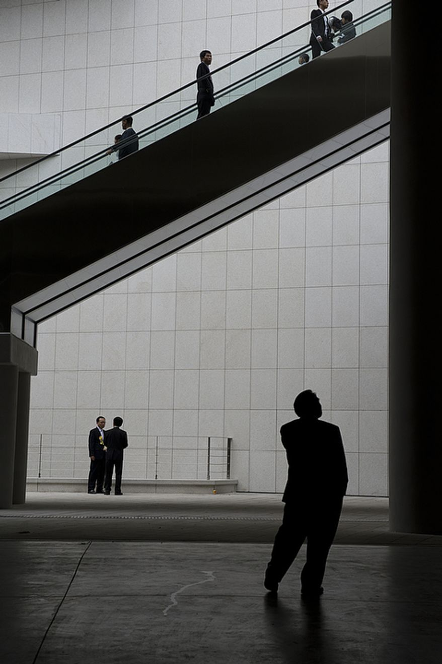 Mourners arrive at the stadium at the Cheong Shim Peace World Center in Gapyeong, Korea on Saturday, Sept. 15, 2012 for the Seonghwa, or ascension, ceremony, for the late Rev. Sun Myung Moon. (Barbara L. Salisbury/The Washington Times)