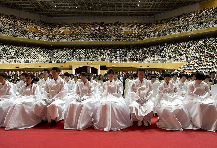 Family members of the late Rev. Sun Myung Moon sit up front in traditional Korean garb at the Seonghwa, or ascension, ceremony honoring their father at the Cheong Shim Peace World Center in Gapyeong, Korea on Saturday, Sept. 15, 2012. (Barbara L. Salisbury/The Washington Times)