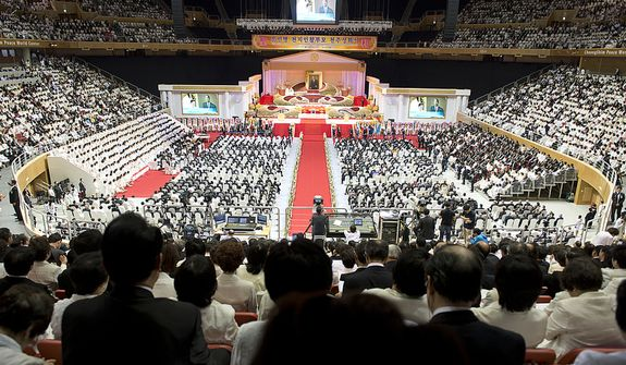 Thousands of people fill the stadium at the Cheong Shim Peace World Center in Gapyeong, Korea on Saturday, Sept. 15, 2012 for the Seonghwa, or ascension, ceremony, known as the traditional funeral in western terms, for the late Rev. Sun Myung Moon. Some 15,000 people fit into the stadium, where the funeral was held, with another 10,000 to 15,000 expected to be watching live simulcasts around the complex. (Barbara L. Salisbury/The Washington Times)