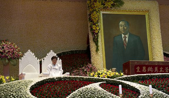 "Mrs. Moon sits in one of two seats reserved for the ""True Parents,"" with the other one being empty, during the Seonghwa, or ascension, ceremony, known as the traditional funeral in western terms, for the late Rev. Sun Myung Moon on Saturday, Sept. 15, 2012 at the Cheong Shim Peace World Center in Gapyeong, Korea. Thousands of mourners from countries around the world came to witness the event and say goodbye to the head of the Unification Church. Some 15,000 fit into the stadium, where the funeral was held, with another 10,000 to 15,000 expected to be watching live simulcasts around the complex. (Barbara L. Salisbury/The Washington Times)"